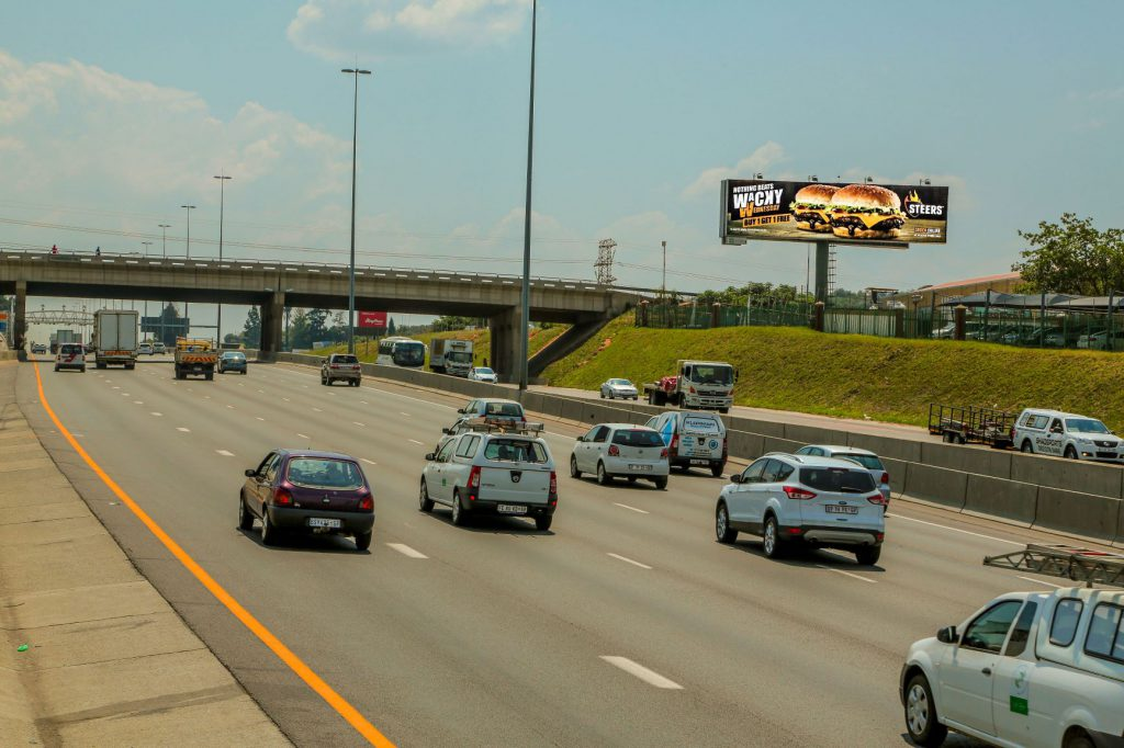 Large format digital billboard on busy highway site in Johannesburg